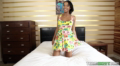 Beautiful Black Female In Sexy Dress Relaxes On Bed